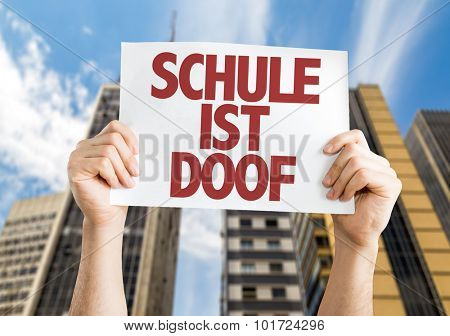School Sucks (in German) placard with cityscape background