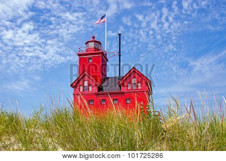 Michigan red lighthouse in dune grass