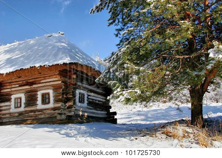 Bright Elegant House Under A Thatched Roof In The Snow. Christmas Landscape. Maybe The Home Of Santa