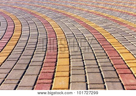 Urban Road Is Paved With Blocks Of Stone, Cobblestone Walkway. Soft Focus