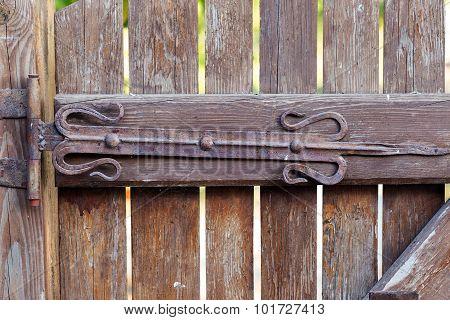 Vintage Metal Wrought Iron Hinges On The Wooden Door