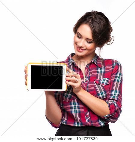 Happy smiling beautiful young woman showing blank tablet pc for copyspace isolated over white background