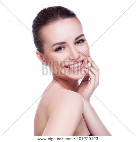 Beautiful face of young adult woman with clean fresh skin - isolated on white