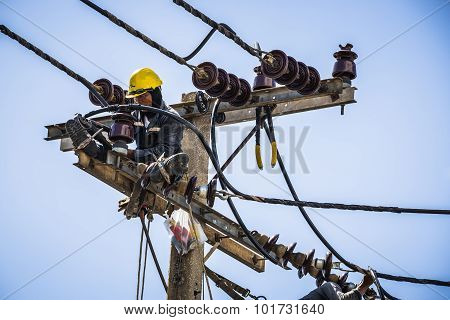 Electrician Working On The Electricity Pole