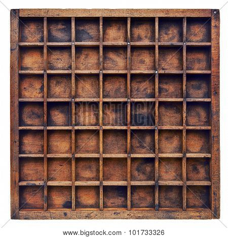 vintage wood  printer  (typesetter) drawer or shadow box with numerous dividers, isolated on white