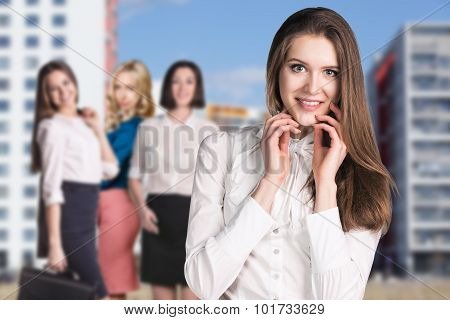 Business women stand on the street