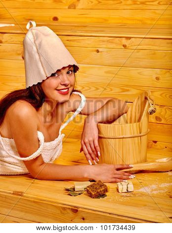 Young smiling woman in sauna.