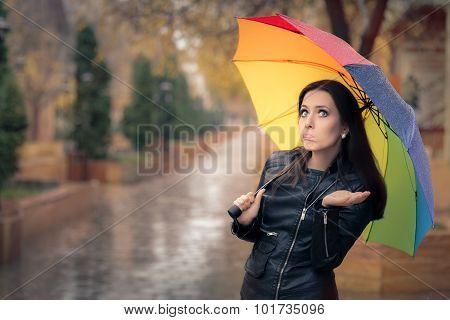 Disappointed Autumn Girl Holding Rainbow Umbrella