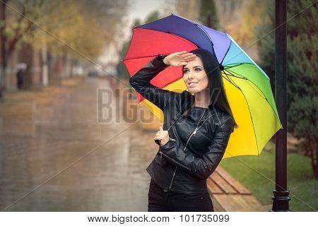 Happy Autumn Woman Holding Rainbow Umbrella Checking for Rain