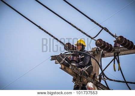Electrician Working On Electricity Pole