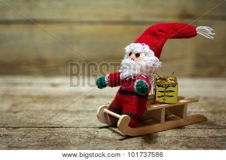 Santa Puppet On A Wooden Sledge