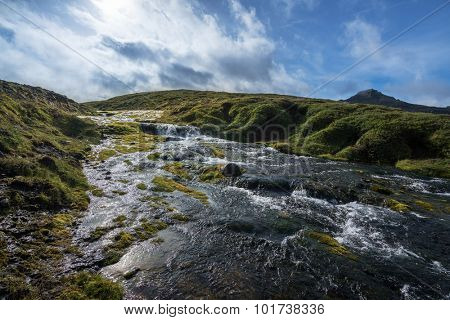 Waterfall cascades in the southern region of Iceland during summer