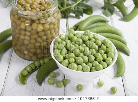 Fresh Green Peas  And Canned Peas In A Glass Jar .