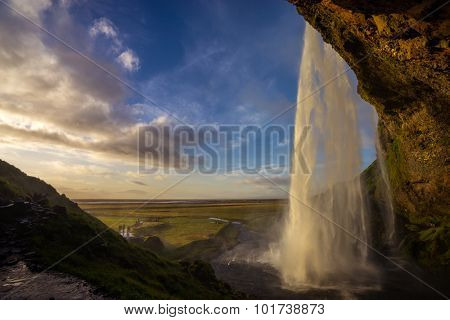 Seljalandsfoss waterfalls during sunset in Iceland