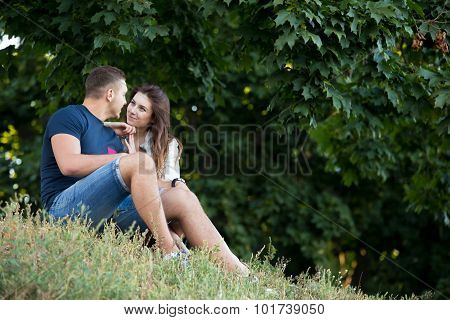 Couple On A Date Resting Under The Trees