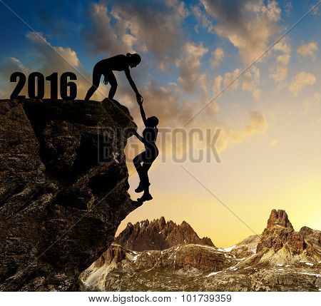 Silhouette girls climbs into the New Year 2016.