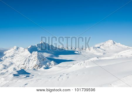 Beautiful Winter Landscape With Snow-covered Mountains And Blue Sky