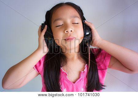 Little Girl Listening To Music.