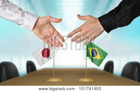 Japan and Brazil diplomats agreeing on a deal