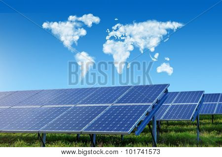 solar panels under blue sky with world map made of clouds
