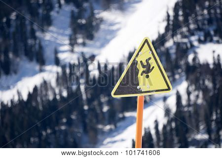 danger steep cliff mountain sign, ski resort