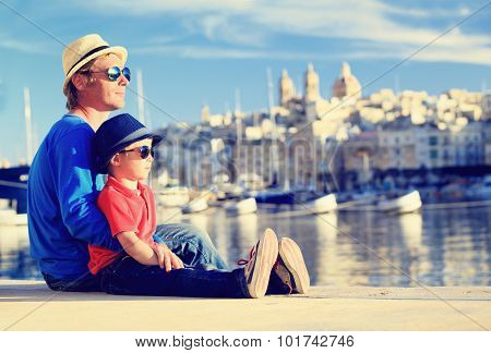 father and son looking at city of Valetta, Malta