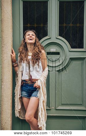 Happy Young Woman In Boho Clothes Standing Outdoors
