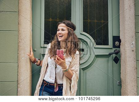 Happy Trendy Hipster Woman With Mobile Phone Standing Outdoors