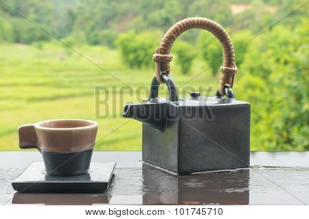 Green Tea In Cup And Teapot On Wooden Table 1