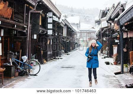 Woman at old district of historical Takayama town in Japan on winter day