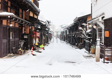 Old district wooden houses at historical Takayama town in Japan on winter day