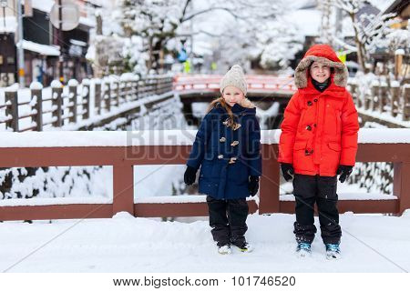 Kids at Takayama town in Japan on winter day