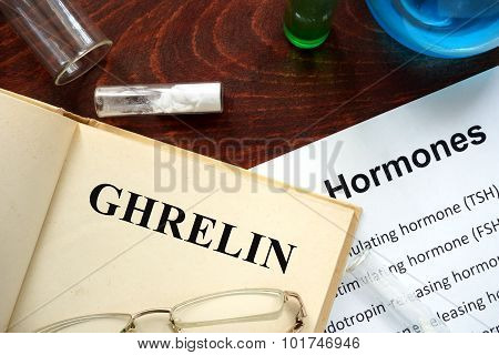 Hormone ghrelin written on book.