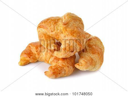 Pile Of Golden Croissant On White Background