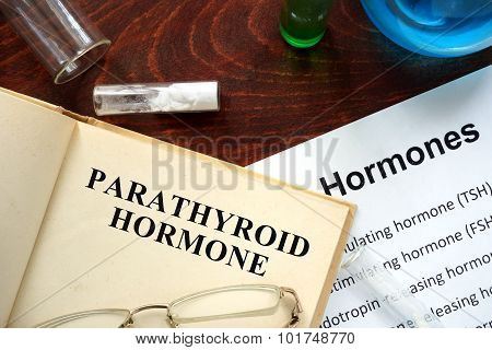 parathyroid hormone (PTH)  written on book.