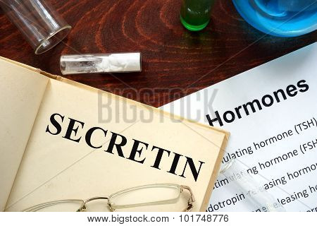 Hormone secretin written on book.