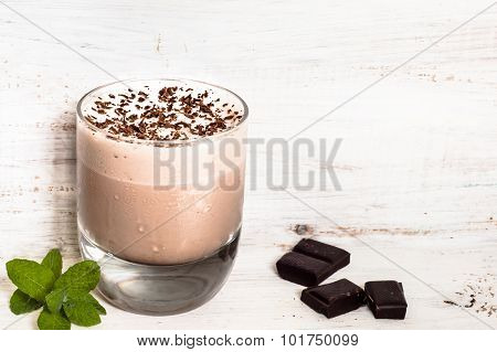 Iced Chocolate Milkshakes In Glass On Wooden Table.