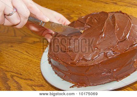 Cutting A Chocolate Cake