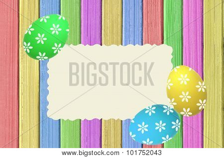 Colorful Easter Eggs And Postcard On Painted Color Wooden Texture