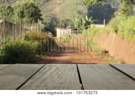 Defocus And Blur Image Of Terrace Wood And Scenery View Of Local Road For Background Usage