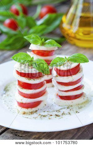 Traditional healthy sliced tomatoes with mozzarella salad caprese. Italian national gourmet food.