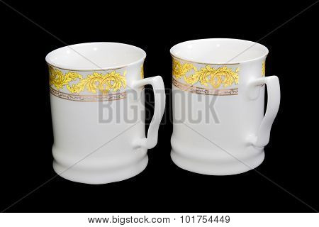Two White Cups On A Black Background