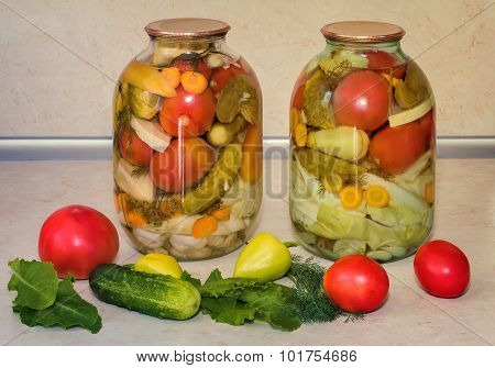 A Variety Of Canned Vegetables In Glass Jars.
