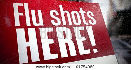 flu shots here against blurry new york street