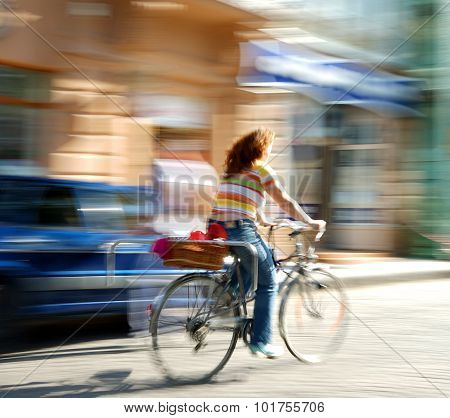 Girl Cyclist In Traffic