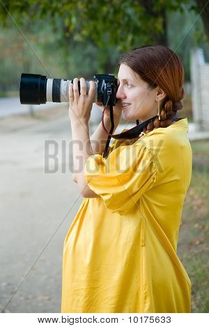 Pregnant Woman  With Photocamera Outdoor