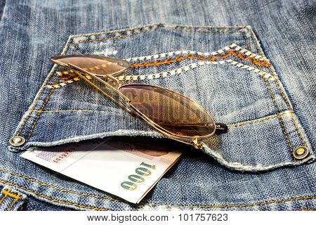 Blue Jeans Trouser With Money And Sun Glasses