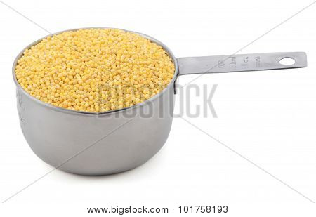 Millet Grains In A Measuring Cup