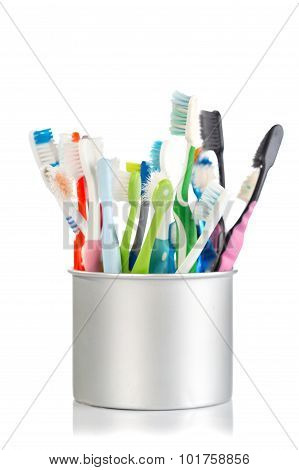 Group Of Old And Used Toothbrush In Metal Cup