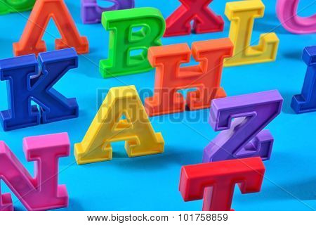 Plastic Colorful Alphabet Letters On A Blue Background